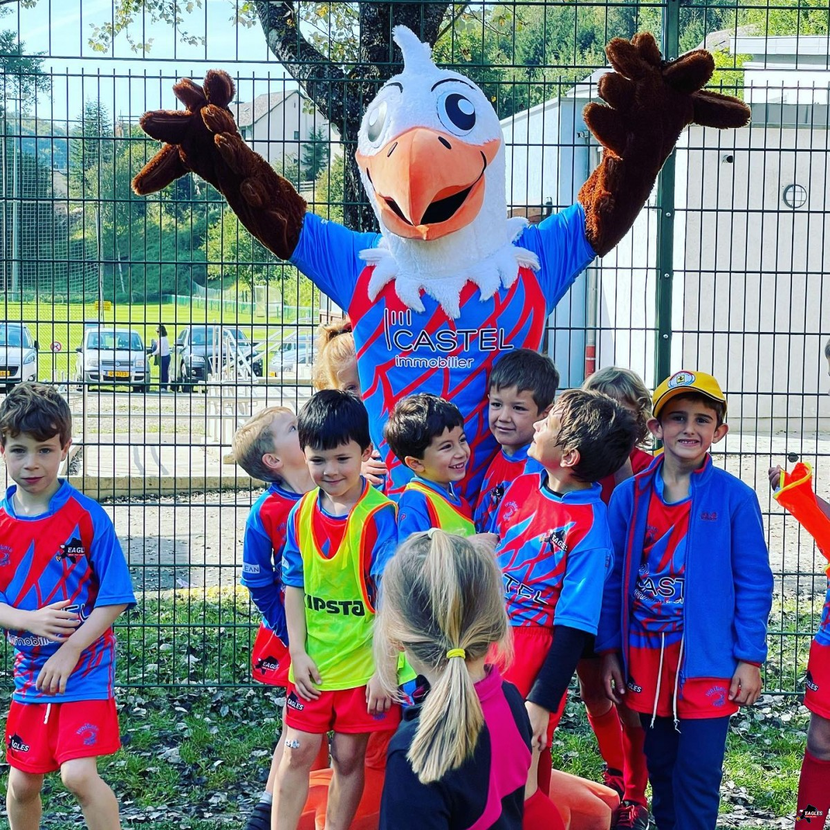 Children with Eagly, a key member of the Rugby Eagles Luxembourg