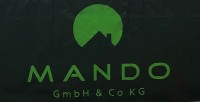Firma MANDO